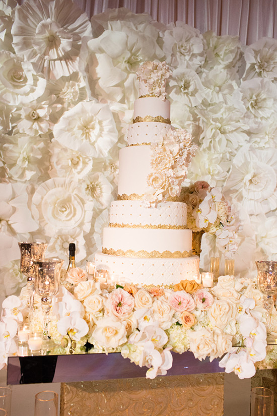 Seven tier wedding cake in white and gold