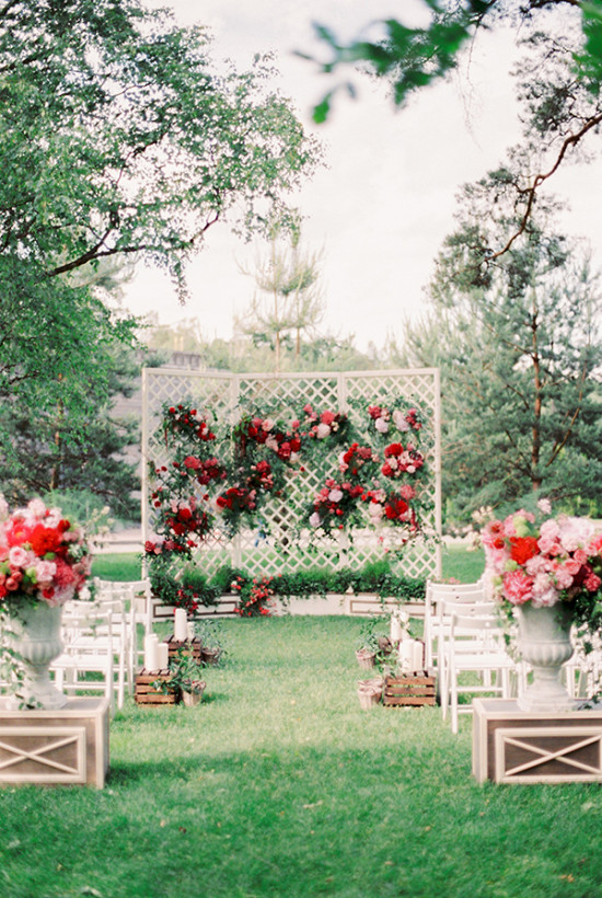 outdoor wedding ceremony in red and pink