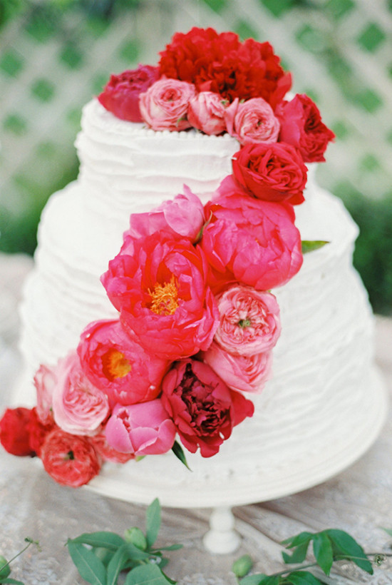 red flowe rtopped wedding cake