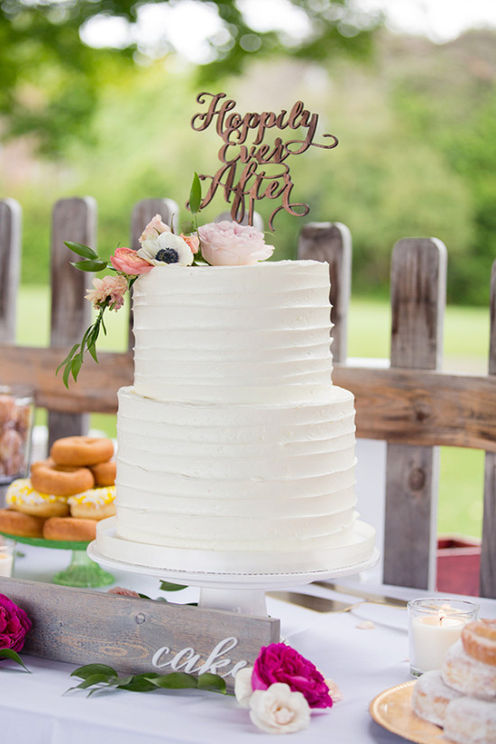 White wedding cake with wood topper