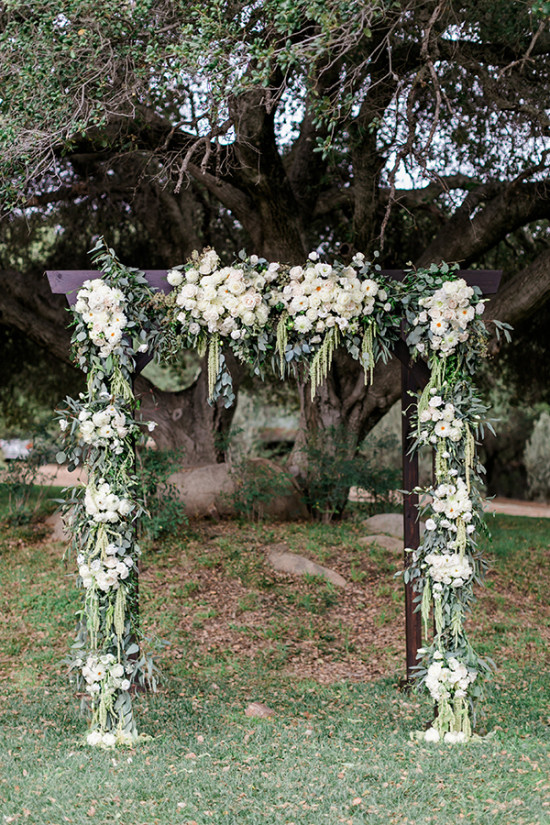 flower filled wedding arch