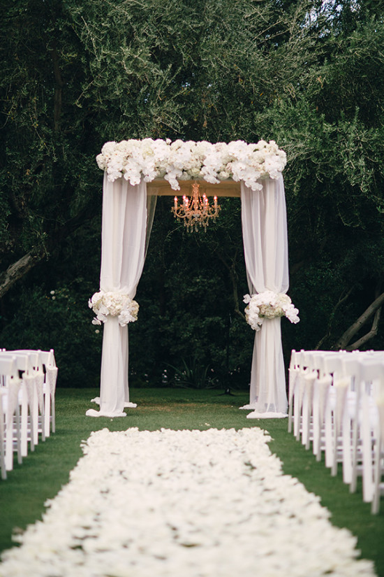 White wedding arch with chandelier