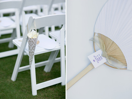 White wedding ceremony fans and flowers