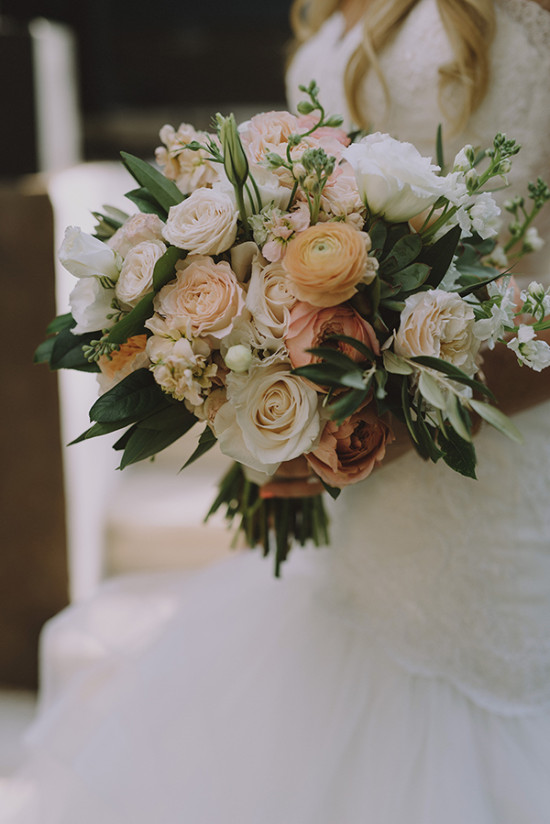 Wedding bouquet in peach and blush tones