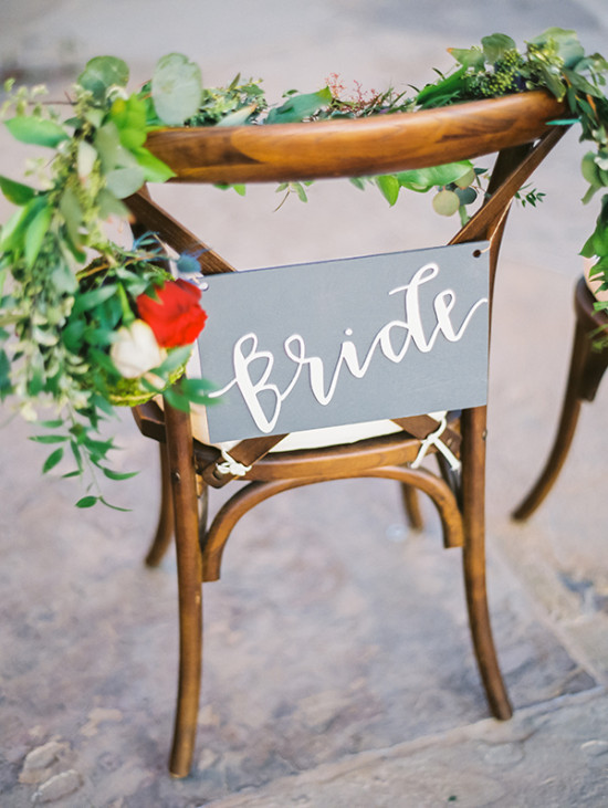 garland accented bride seat sign
