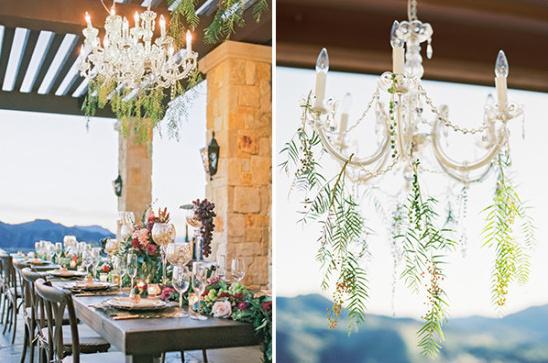 greenery accented chandeliere
