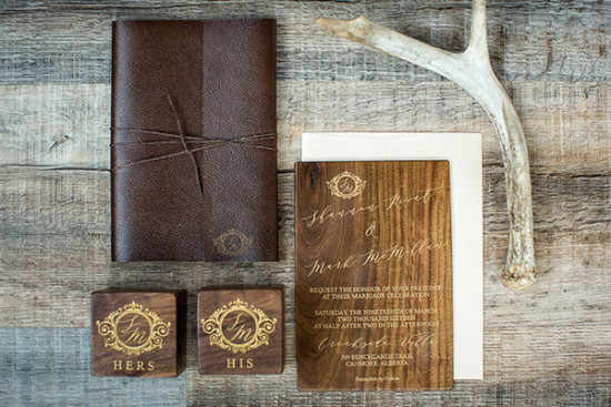 Rustic wood and leather invite