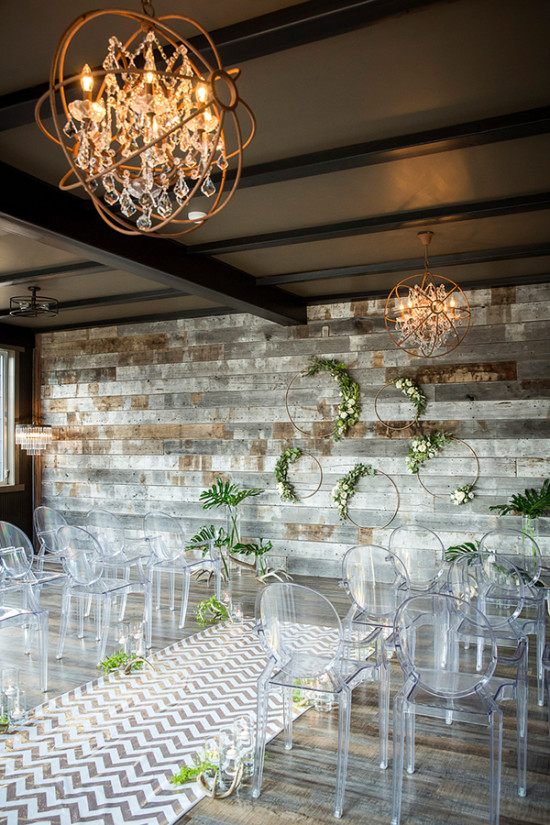 Modern rustic ceremony decor with reclaimed wood wall
