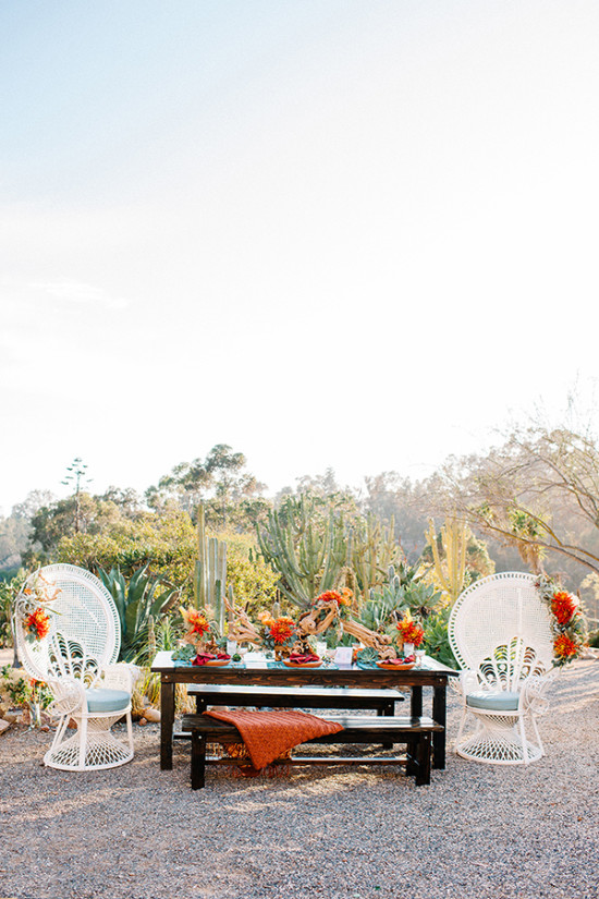 Teal and red desert wedding decor