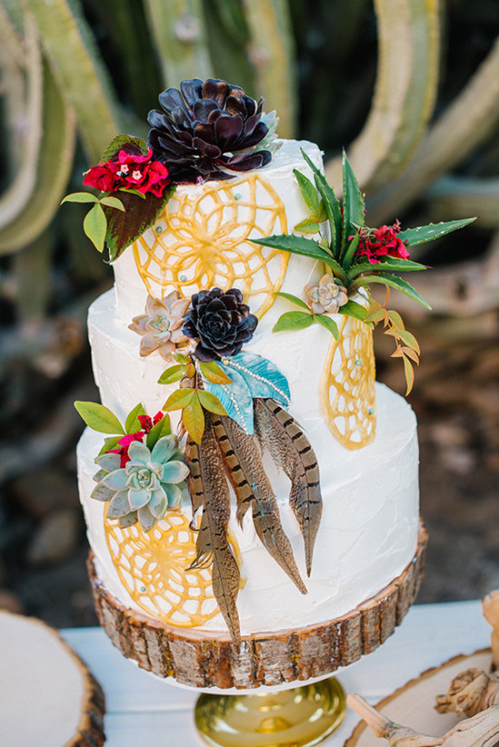 Wedding cake with dreamcatchers and feathers