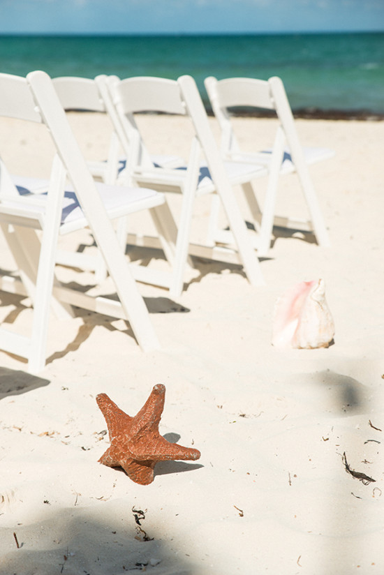 Beach ceremony seashell decor