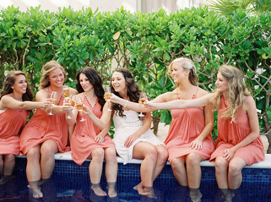 Bridesmaids relaxing poolside