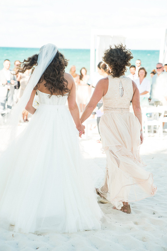 Mother daughter walk down aisle