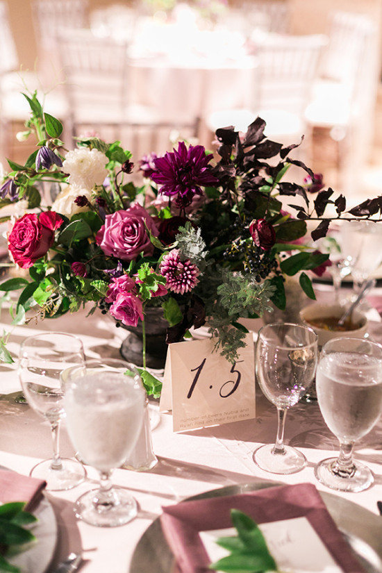 purple centerpiece and table number