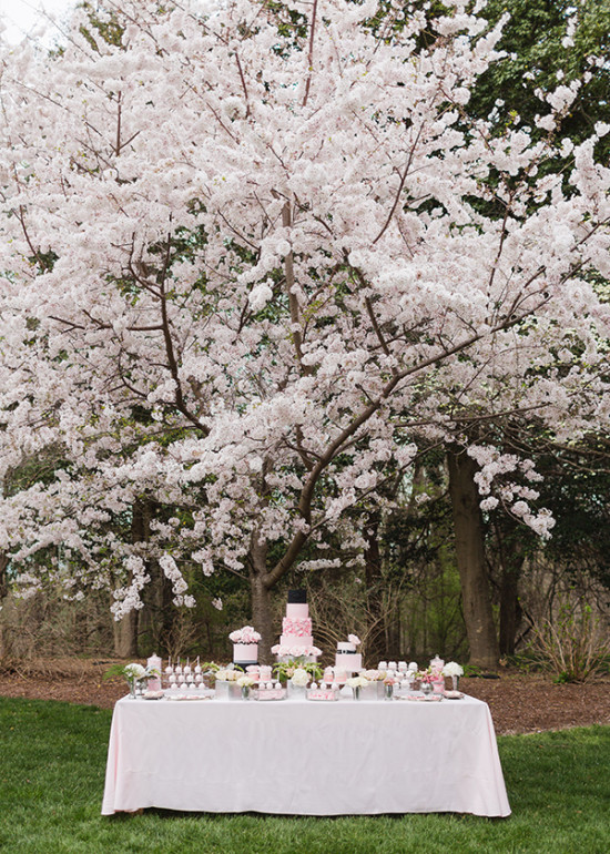 wedding cake dessert table in black and pink