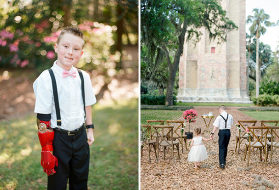 ring bearer in bow tie and suspenders