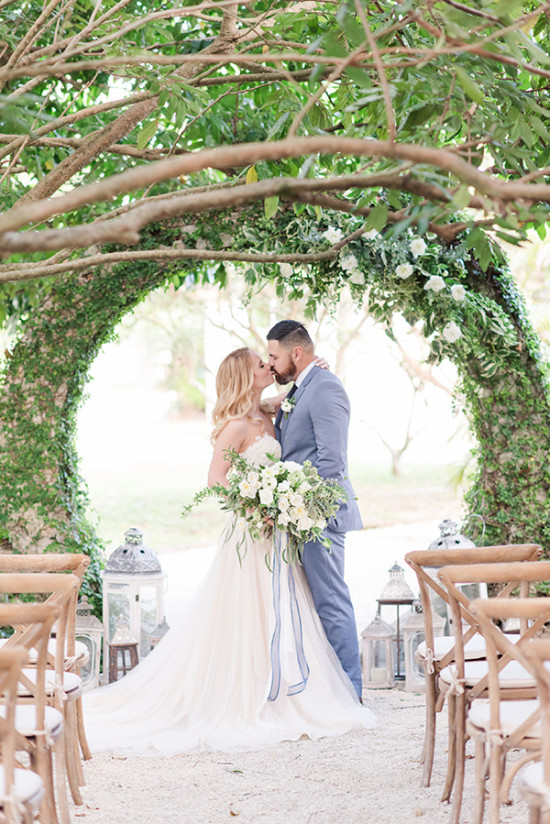 romantic hedge arch backdrop for wedding ceremony