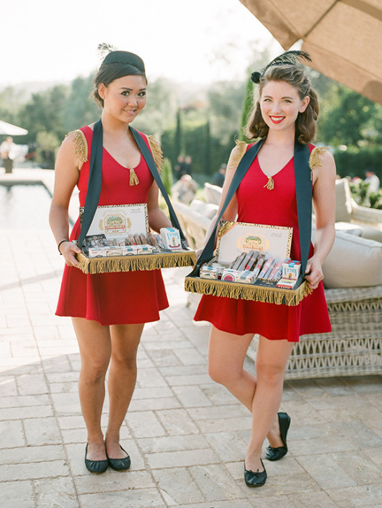 guests were greeted by cigarette girls with candy cigars and cigarettes