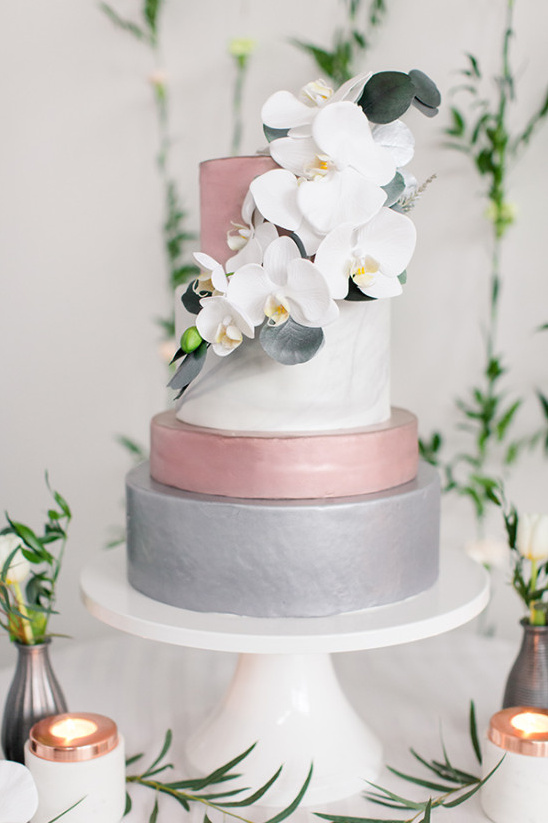 Pink white and grey cake with orchids