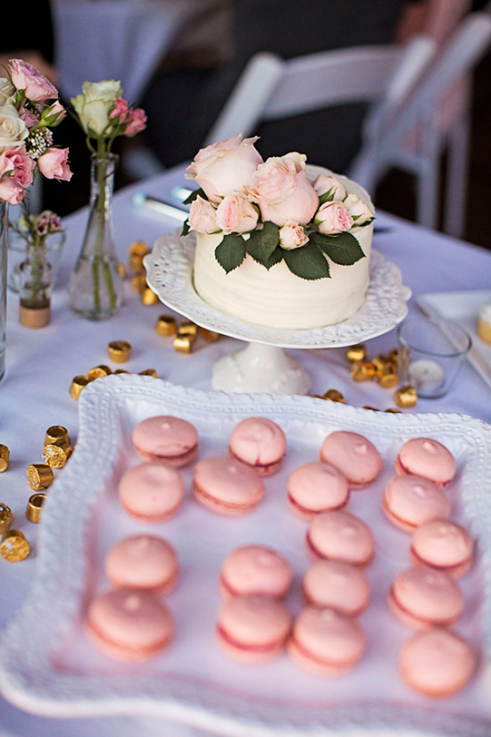 french macarons and rose topped mini cake