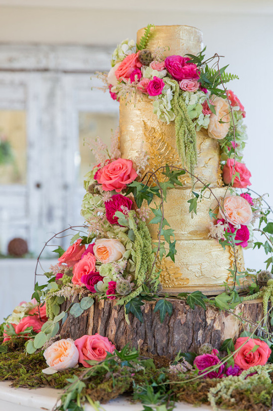 gold wedding cake with flowers