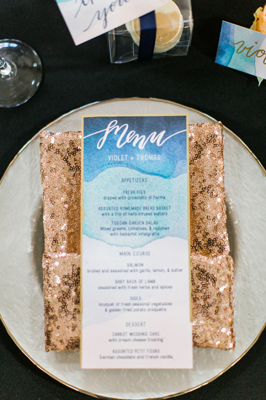 gold and blue place setting with watercolor menu