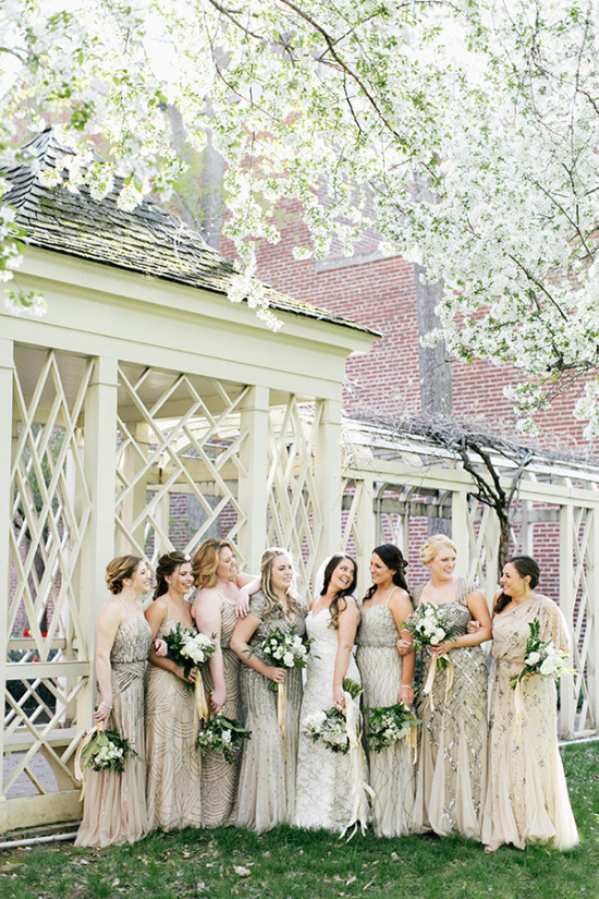 bridesmaids in assorted champagne and gold dresses