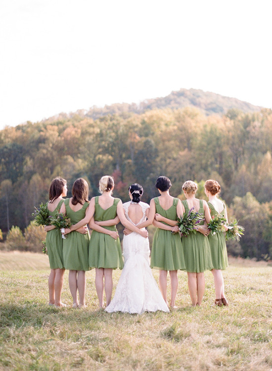 Bridesmaids in sage green dresses