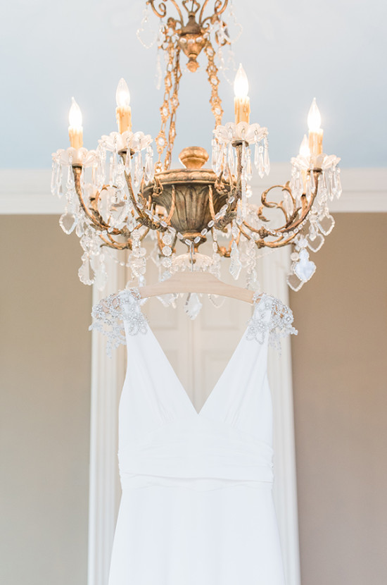glam chandeliere with glamorous Amy Kuschel wedding gown