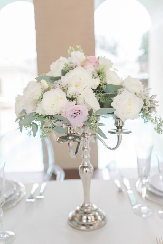 silver candelabra floral centerpiece in white and pink