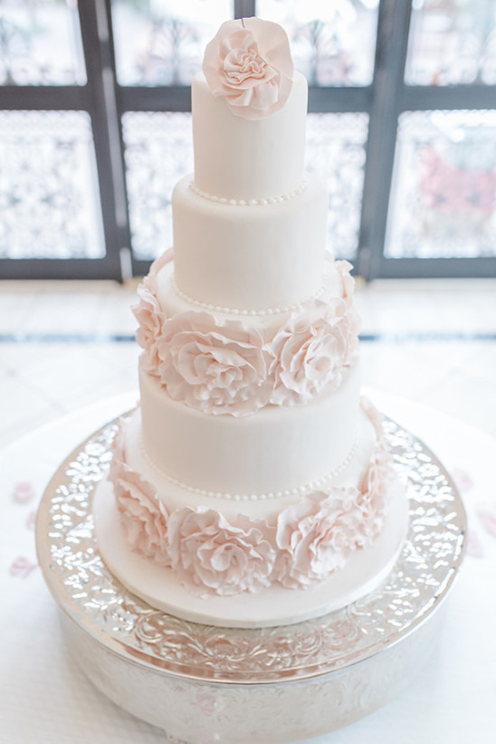 blush and white wedding cake with sugar rose accents