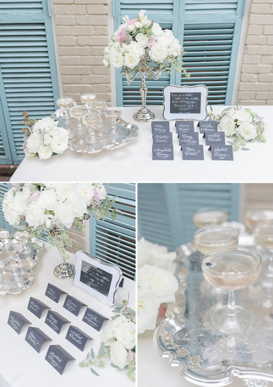 classy silver white and characoal gray welcome table with welcome cocktails