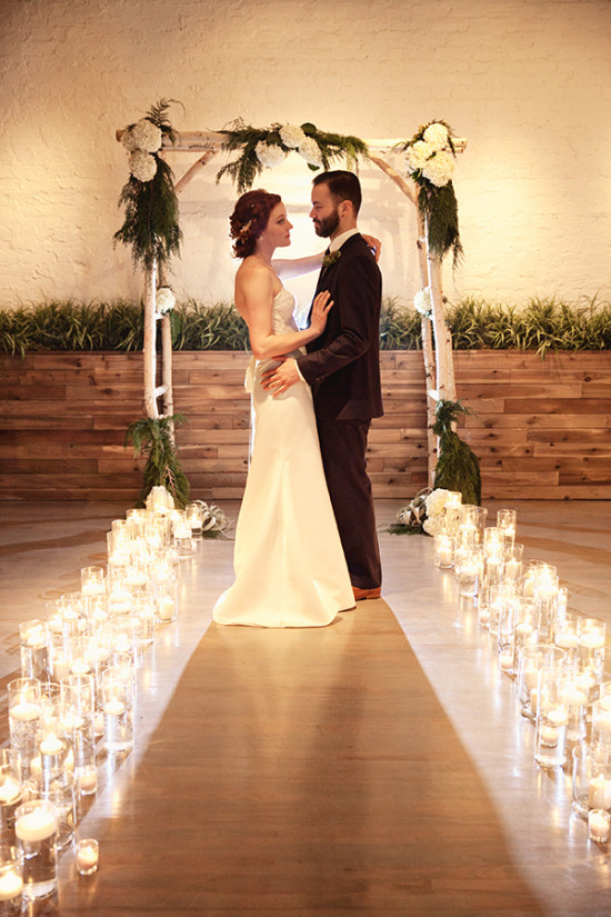 aspen and floral wedding arch with candles