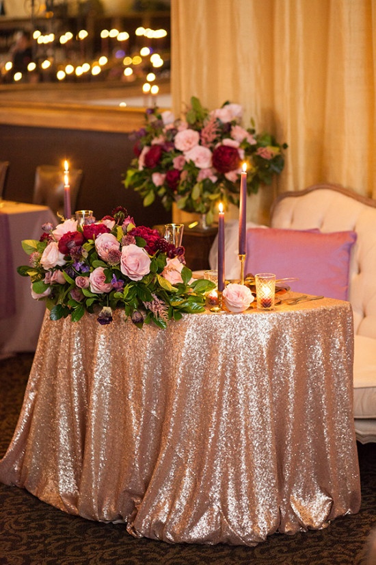 Sweetheart table in gold and purple