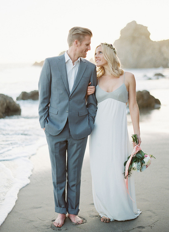 grey and white bride and groom beach outfits