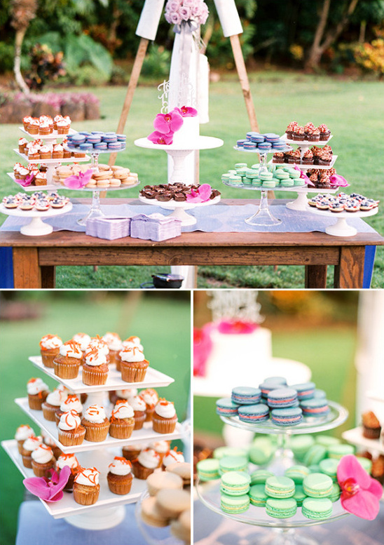 colorful dessert table with mini cupcakes macarons and a mini wedding cake