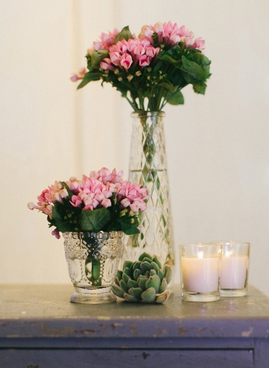 pink floral decor with succulents