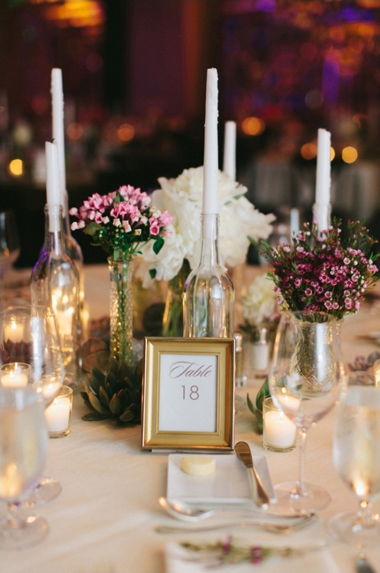 elegant table number with wine bottle candle holders