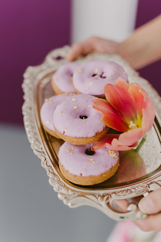 purple donuts with gold flakes
