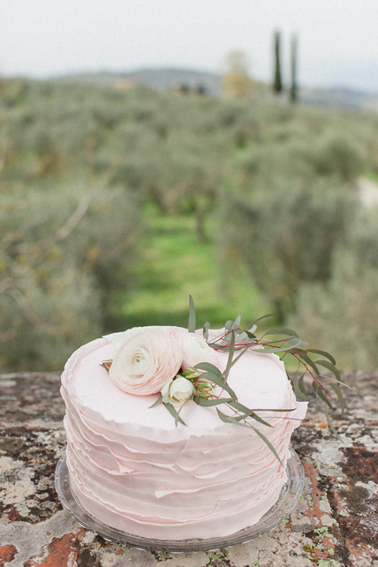 Blush wedding cake with ruffles