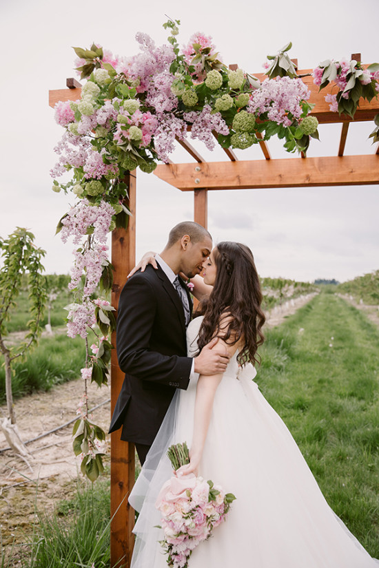 Ceremony pergola with pink florals