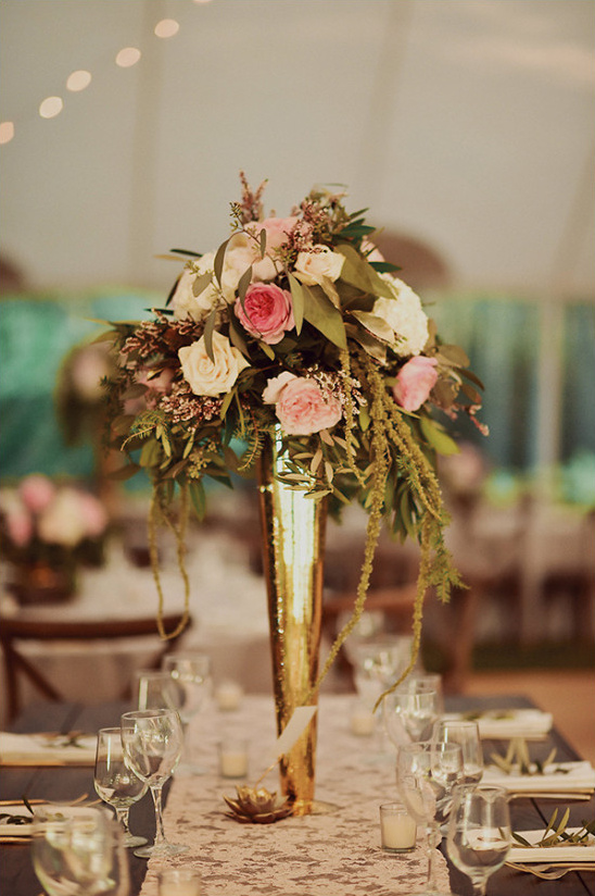elegant centerpiece in tall gold vases