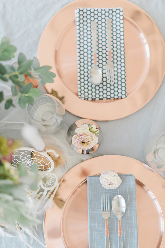 copper place setting with patterned napkins