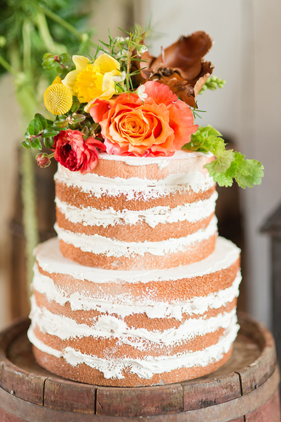simple naked wedding cake with flowers