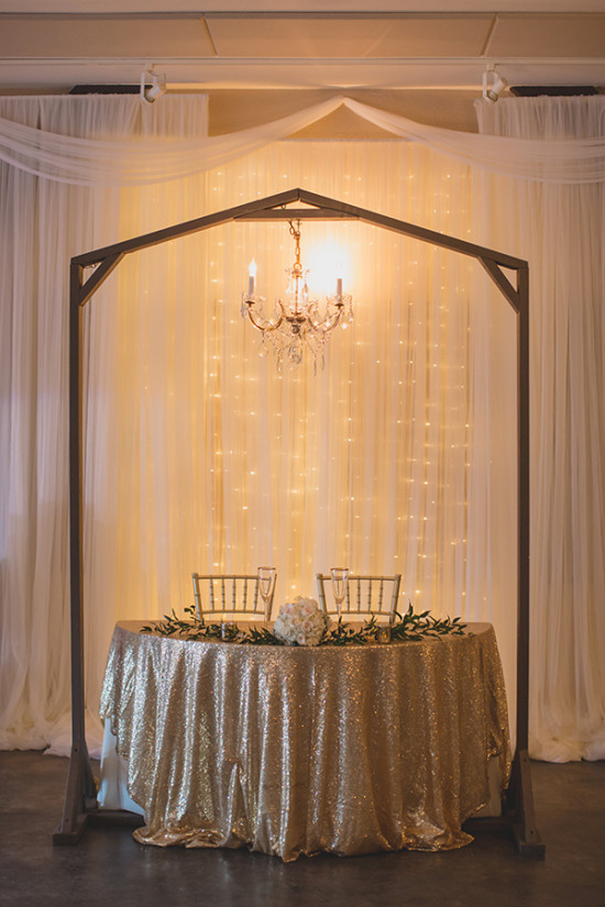 simple and elegant sweetheart table decor