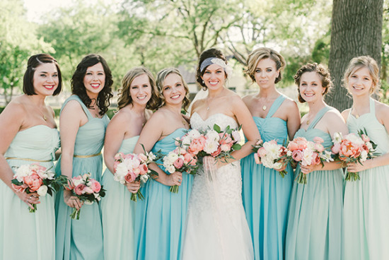 bridesmaids in assorted blue dresses