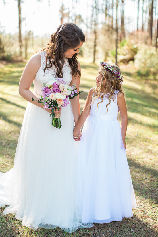 bride and her flower girl dressed in all white