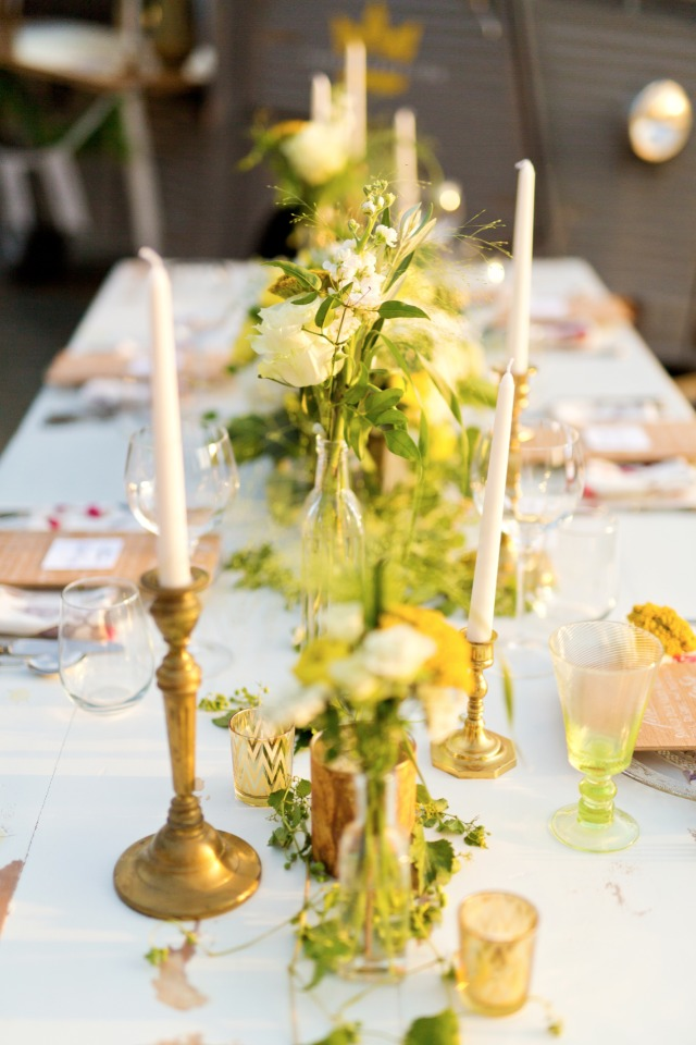 White yellow and green centerpieces with candlesticks