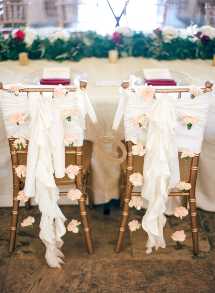 Sweetheart chairs with ruffles and flowers