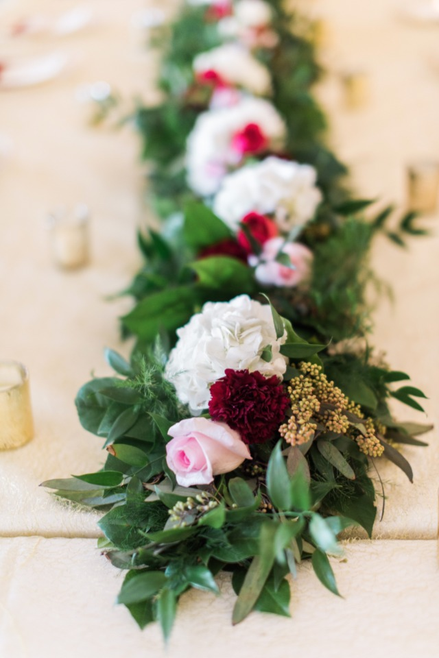 Long red white and pink wedding centerpiece